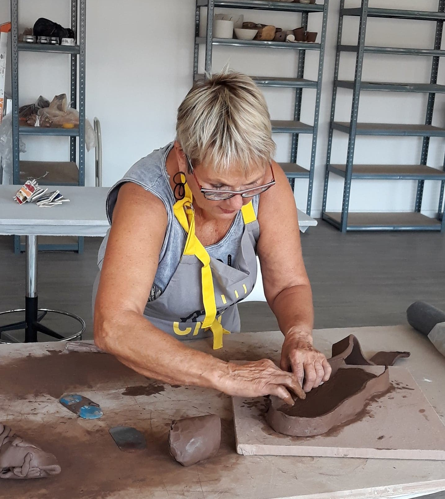 woman shaping clay with hands